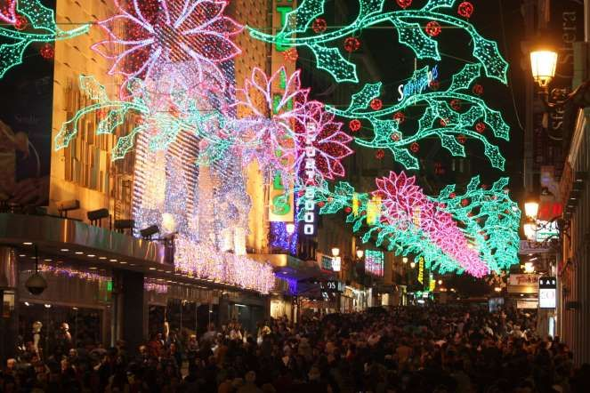Best Places to feel Christmas - santi burgos/Bloomberg news - Madrid, Spain -        Madrid gets in a full swing during the Christmas season. There is plenty of stuff to keep visitors entertained, from the Christmas market to a number of pop-up ice rinks.