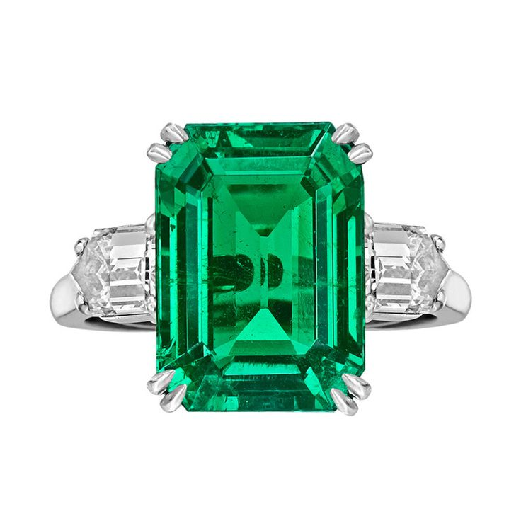 VAN CLEEF & ARPELS 8.20 Carat Colombian Emerald-Cut Emerald & Diamond Ring | From a unique collection of vintage cocktail rings at http://www.1stdibs.com/jewelry/rings/cocktail-rings/
