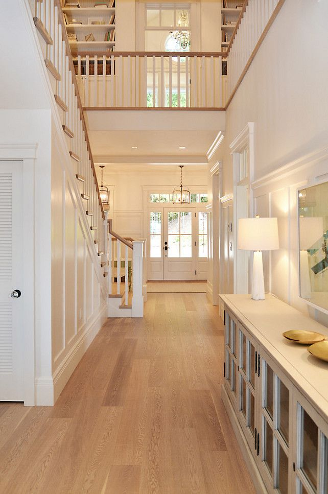 All white staircase and hallway, staircase landing with built in bookshelves Sunshine Coast Home Design.