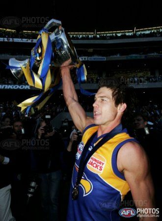 Ben Cousins of the Eagles celebrates with the trophy after the AFL Grand Final match between the Sydney Swans and the West Coast Eagles at the Melbourne Cricket Ground on September 30, 2006 in Melbourne, Australia.