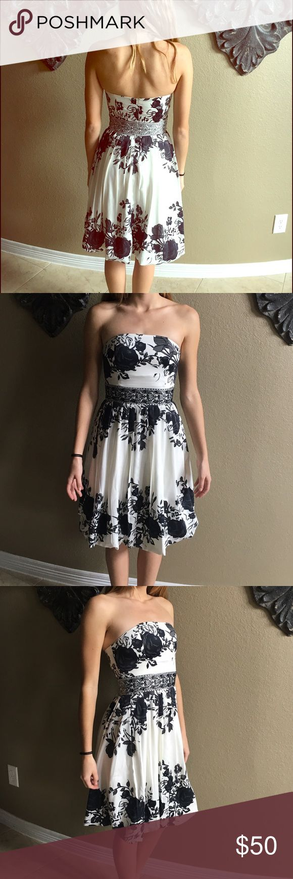 Cute party dress Black and white floral occasion dress. Super cute and in perfect condition! Dresses Strapless