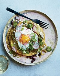 Learn to make this best-ever version of chilaquiles, piled high with tostadas, green salsa and black beans, at Food & Wine.
