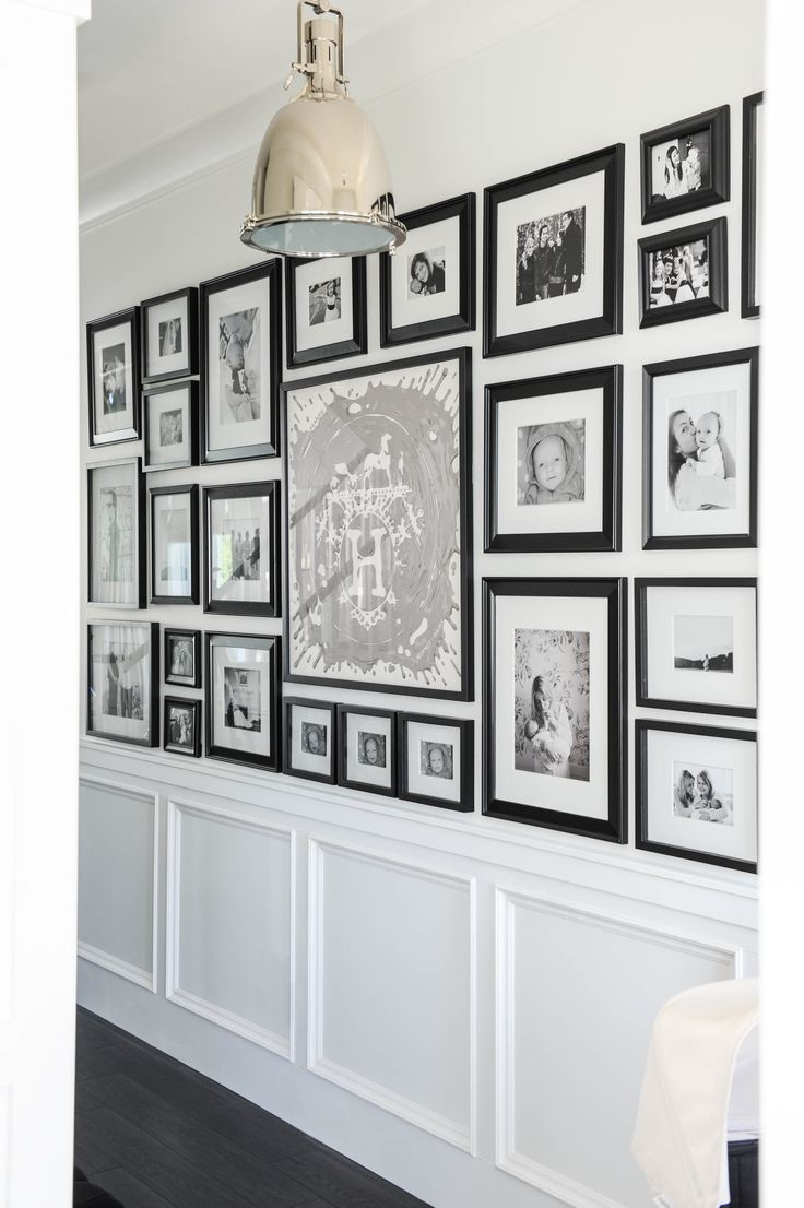 #family-photos, #photos, #scarf, #gallery-wall, #artwork, #black-and-white, #hallway, #molding Photography: Tracey Ayton - traceyaytonphotography.com Read More: http://www.stylemepretty.com/living/2014/03/24/the-doctors-closet-home-tour/