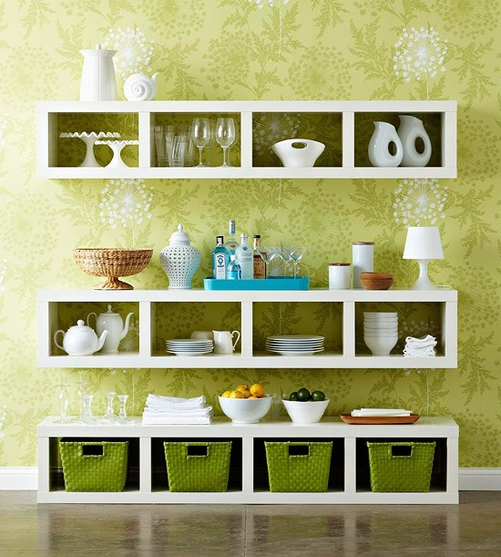 Hang a pair of bookcases horizontally on the wall, then slide a third on the floor below. Display favorite dinnerware and keep serving pieces handy in the cubbies. Install the middle bookcase at counter height so it serves double-duty as a buffet station or bar. @ Home Interior Ideas