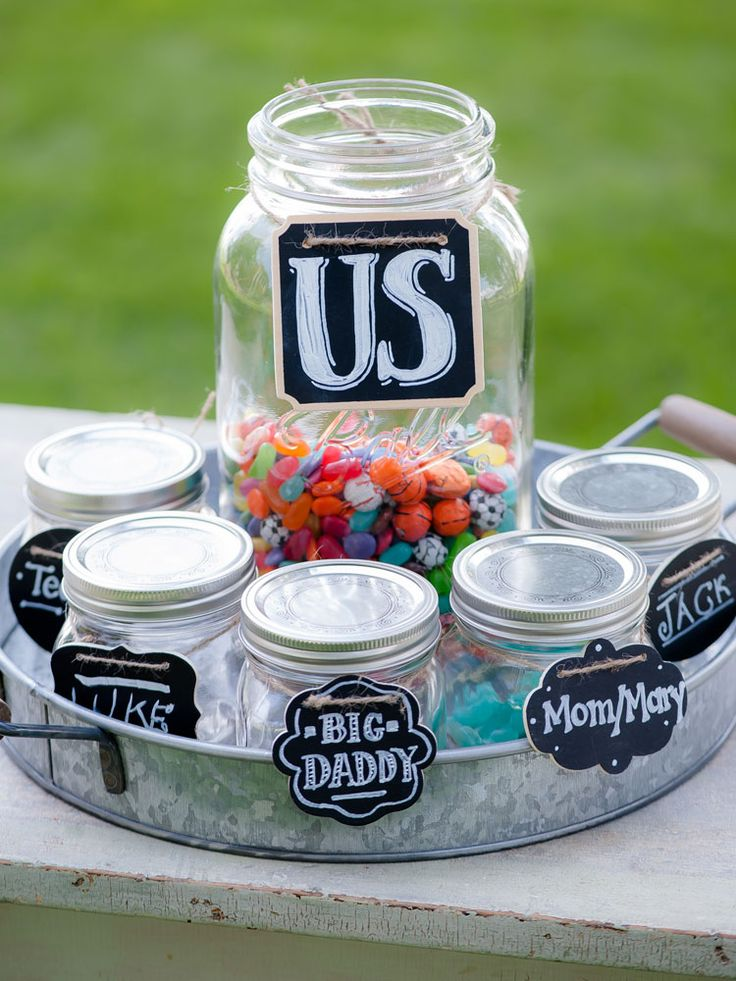 This couple celebrated their blended family at their wedding with a candy jar ceremony. Such a cool idea!