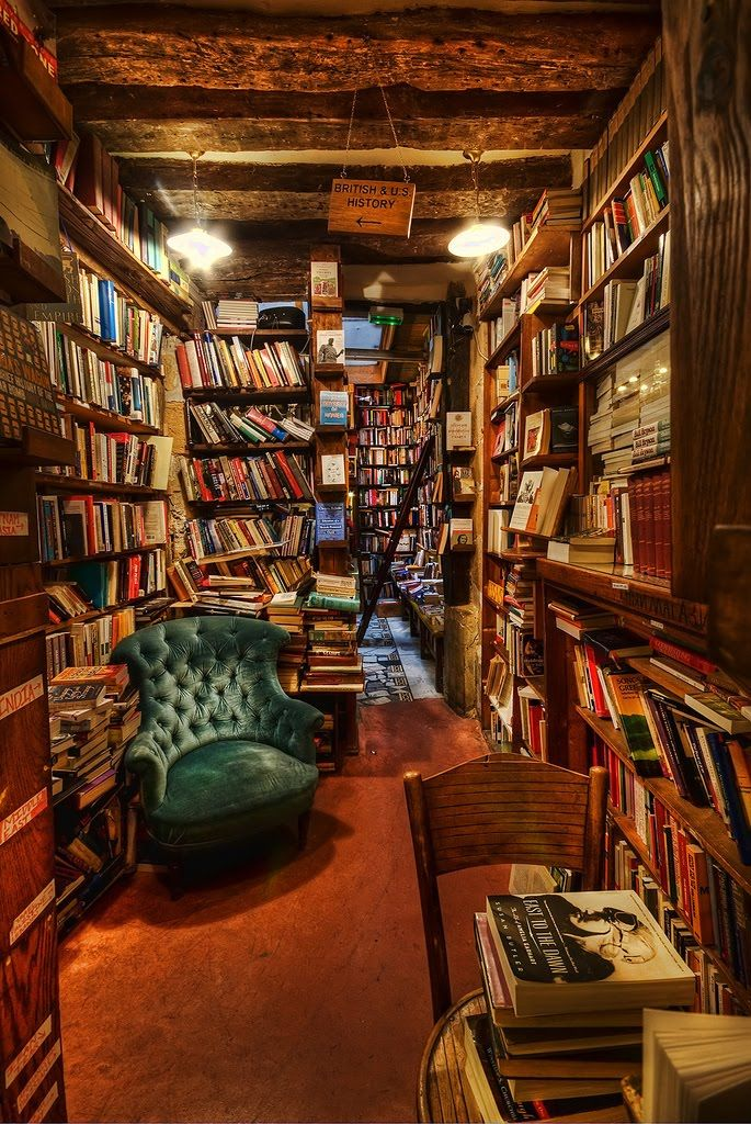 Shakespeare & Co. in Paris. One day I will visit and spend hours and hours curled up in that chair reading.