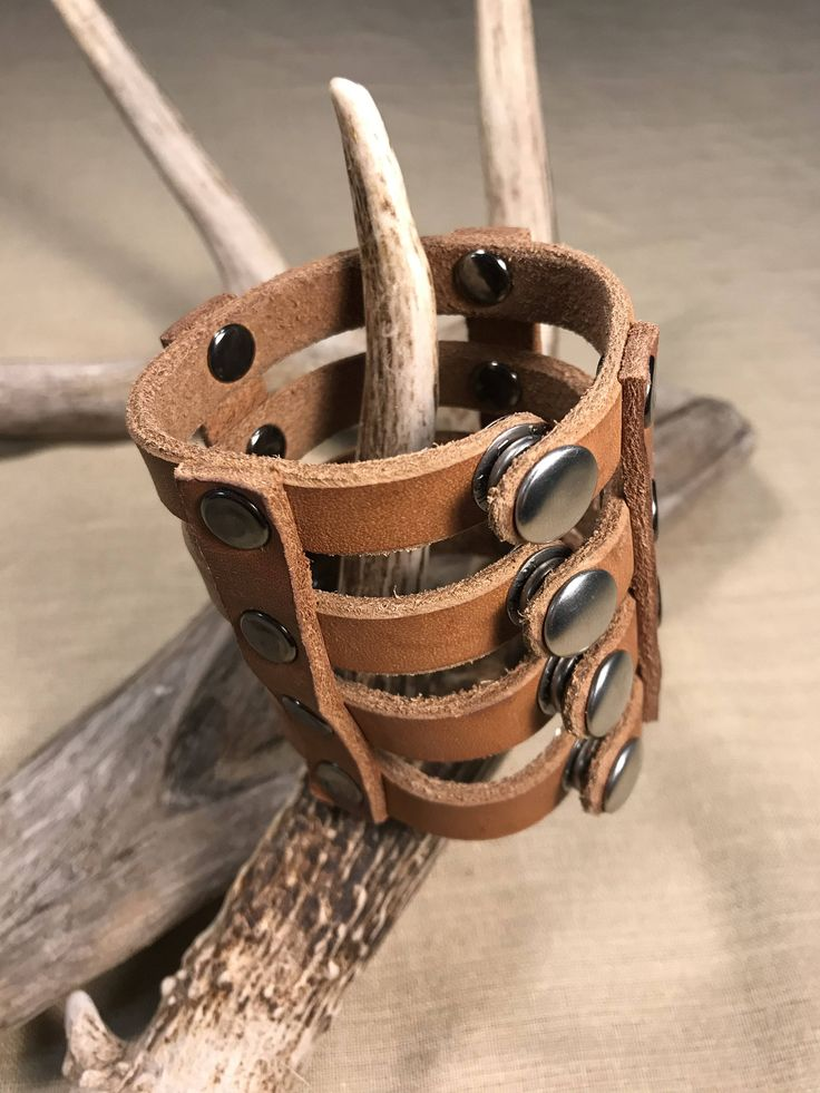 Strappy Leather Cuff by RavenHornLeather on Etsy https://www.etsy.com/ca/listing/561278554/strappy-leather-cuff