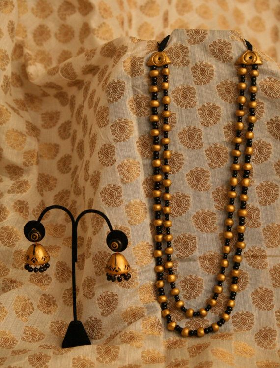 Multi strand necklace with jhumkas by Bagoholics on Etsy