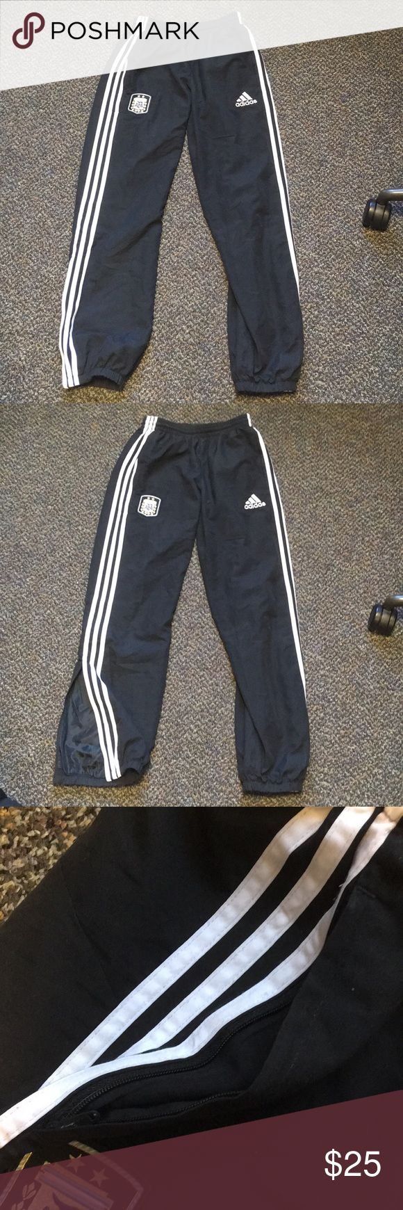 Adidas athletic sweatpants w/ Argentina team patch Adidas sweatpants bought in Italy has Argentina soccer team logo patch (originally bought with that on) kids xl, but fits women's small. Slightly used. 100%polyester. Elastic and drawstring waist, elastic cuffed pant ends, zippered pockets, and zipper half way up calf (see pics). adidas Pants Straight Leg