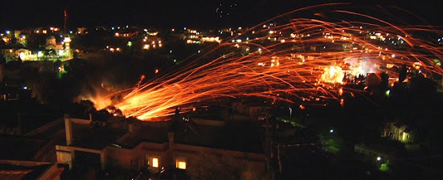 Fireworks streak across the sky by church on island of Chios  Residents admit it is not the most safety conscious of ceremonies  Every Easter Sunday on the small Greek island of Chios a fireworks war breaks out between two rival parishes.    Read more: http://www.architecture-balar.com/2012/04/art-of-easter-rocket-war-in-greek-isle.html#ixzz1s7E3palk