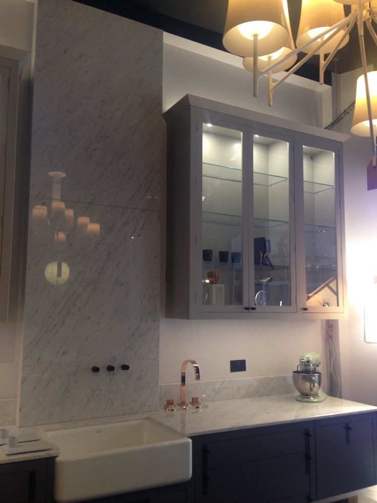 Bianco Carrara Splash Back with Vein Matched and Mitred Returns.  Is this the worlds tallest marble splash back?