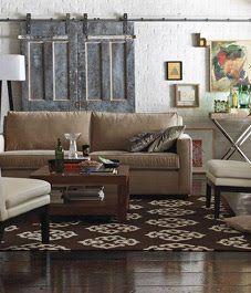 Brown rug on brown floor