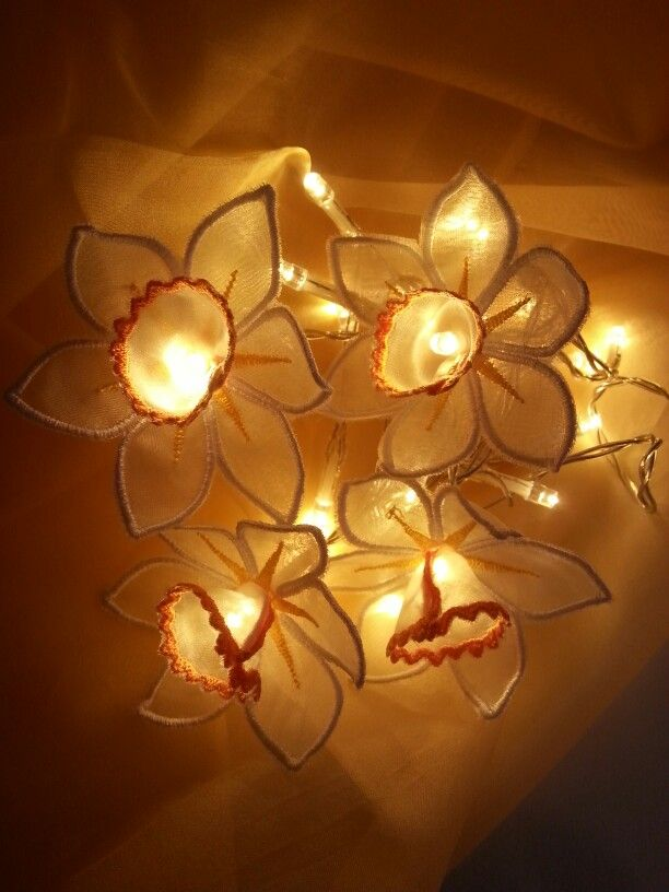 Machineembroidered daffodils on fairylights