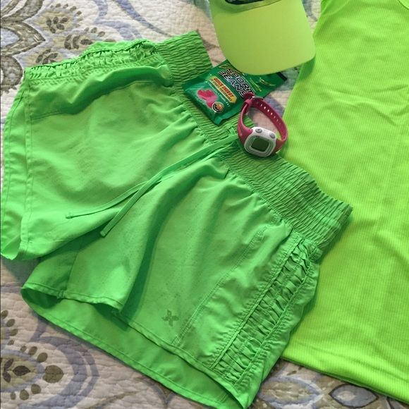 Xersion lime green ruffle side shorts With built in panty. Perfect condition. Beautiful color and very cute on, feminine with the ruffle/rouching in the sides. Shorts