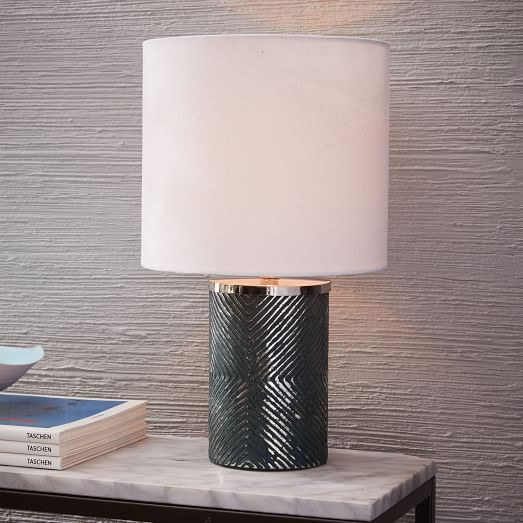With its diamond print etched into antique style mercury glass this art deco inspired lamp adds instant glam to any desk or bedside table