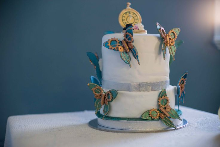 our steampunk butterfly cake, made by my sister and Aunt. Cake topper consisted of icing pocket watch made my my aunt and a tiny top hat, tea cup and little flowers made by my sister-in-law, that featured on our engagement cake.