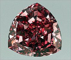 Although many people perceive diamonds to be quite rare, the reality is that tons of diamonds are found each year, and that there are a very large number of diamonds throughout the world. True rarity, however, is found in colored diamonds, for which there are only a small number. The rarest of the colored diamond is the red diamond, with there being only a few dozen in existence. The largest of these is 100+carats,the Moussaieff Red Diamond.