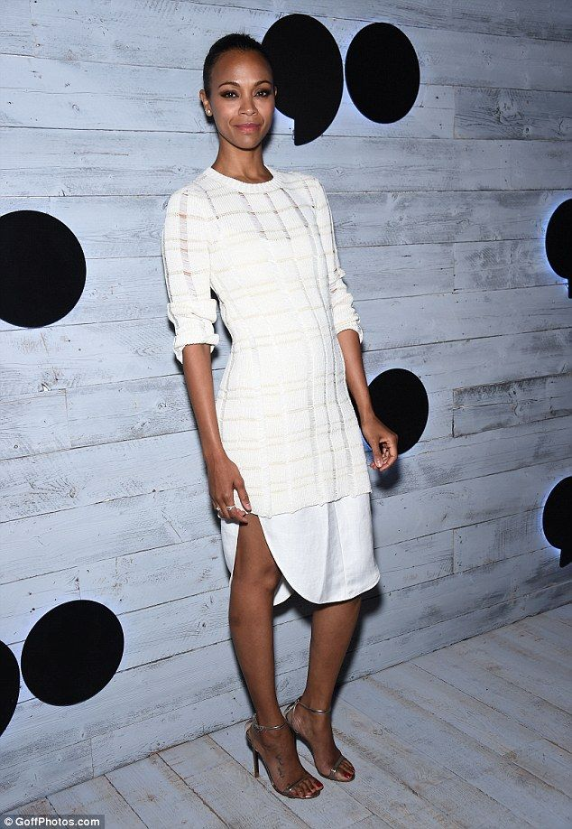 Out of this world! Avatar star Zoe wowed in a white dress, putting on a leggy display...