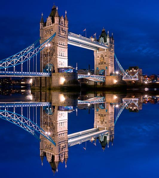 London's Tower Bridge, mirrored in the Thames.
