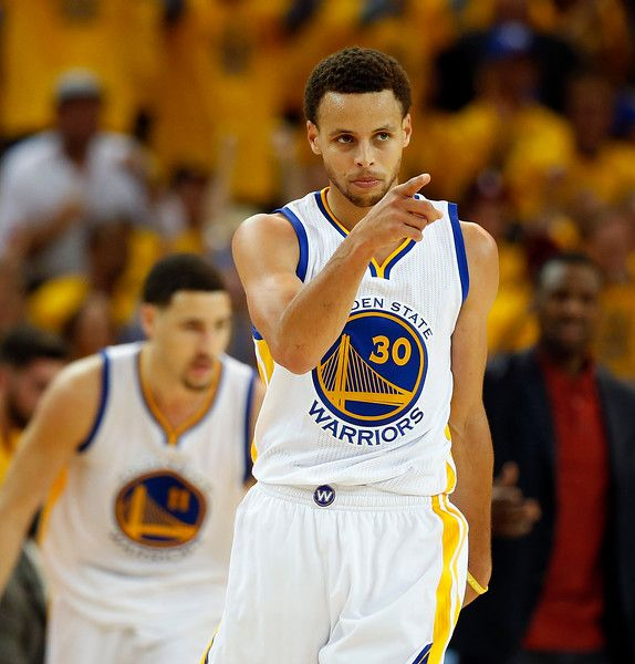 Description of . Golden State Warriors\' Stephen Curry (30) celebrates in the third quarter of Game 5 of the NBA Western Conference semifinals against the Memphis Grizzlies at Oracle Arena in Oakland, Calif., on Wednesday, May 13, 2015. (Ray Chavez/Bay Area News Group)