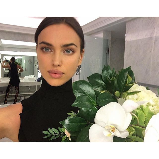 "Irina Shayk - ""I think the new trend is less is more. Everyone's going for a natural look. Natural nails are sexy—nude or no nail polish at all. I always pull my hair back in a low bun, it's easy and classic."""