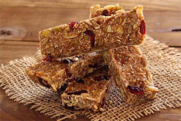 Super easy recipe for a delicious and nutritious paleo energy bar. No grains, gluten or refined sugar. Great for after-school snacks or on-the-go adults. Cheaper and better for you than the store-bought brands too. Try this one! • Nutty Pumpkin Spiced Paleo Energy Bars
