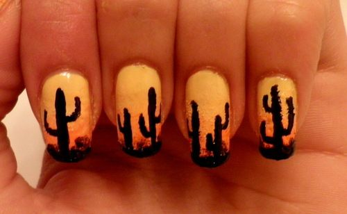 """Today's Daily Nail Art design are these Arizona summer inspired cactus nails. Thenailpro did a 3 color gradient for the background and carefully used a small detailing brush to create the cacti silhouettes in black. The cacti are really simple to do, just make 2 or 3 vertical lines of different heights, then attach 2 """"L"""" shaped limbs of different sizes. I think this is a really unique design, since you don't normally expect to see a cactus on your fingernails."""