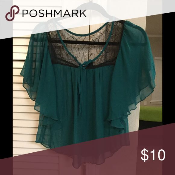 💋Sheer Cropped Blouse💋 Teal colored. Lace at the top. Front tie closure. Not a crop top but is Cropped meaning it is a shorter blouse. Only worn once. In excellent condition! Forever 21 Tops Blouses