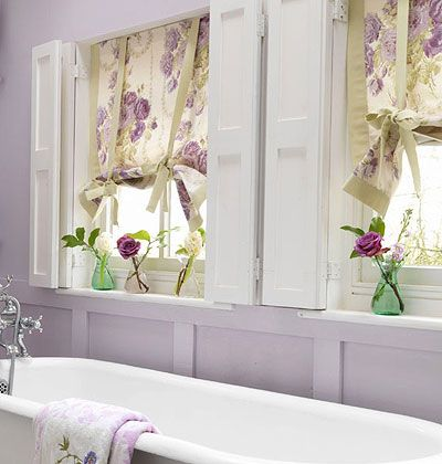 Give Roman curtains a flirty, feminine feel by securing them with ribbons tied in pretty bows at the bottom.