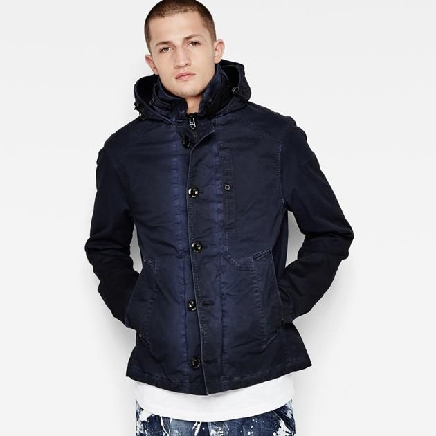 Fitted out with classic trench details like an asymmetrical front yoke, belted collar and long cuff adjusters, this jacket length version features a tall...