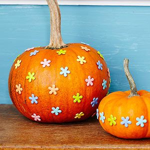 This design couldn't be easier: just press a pattern of scrapbooking brads into your pumpkins!