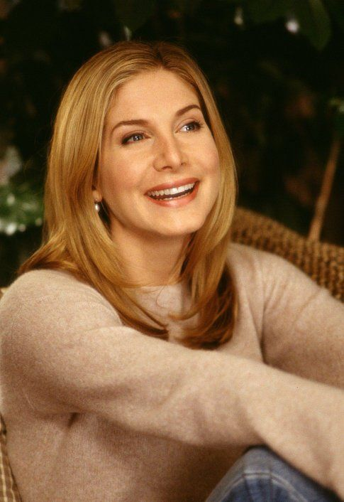 Elizabeth Mitchell plays Carol, a prospective Mrs. Claus.