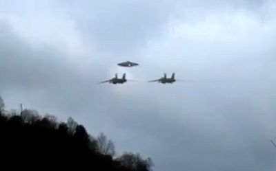 UFO SIGHTINGS DAILY: Two Military Jets Escorting UFO To Secret Base, Alien Tech In Military Hands? UFO Sighting News. http://www.ufosightingsdaily.com/2011/08/two-military-jets-escorting-ufo-to.html