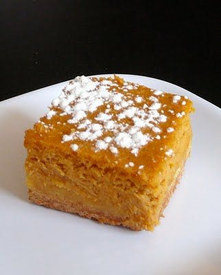 Pumpkin Gooey Butter Cake  Recipe from Paula Deen     Cake:  1 18 1/4-ounce package yellow cake mix  1 egg  8 tablespoons butter, melted    Filling:  1 15-ounce can of pumpkin  1 8-ounce package cream cheese, softened  3 eggs  1 teaspoon vanilla  8 tablespoons butter, melted  1 16-ounce box powdered sugar  1 teaspoon cinnamon  1 teaspoon nutmeg    Preheat oven to 350 degrees.    To make the cake, combine all of the ingredients and mix well. Pat the mixture into a lightly greased 13x9-inch…