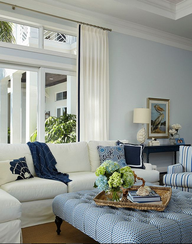 Living room ottoman fabric ideas. Pierre Frey fabric garbs the Lee Industries tufted ottoman at the center of the living room.