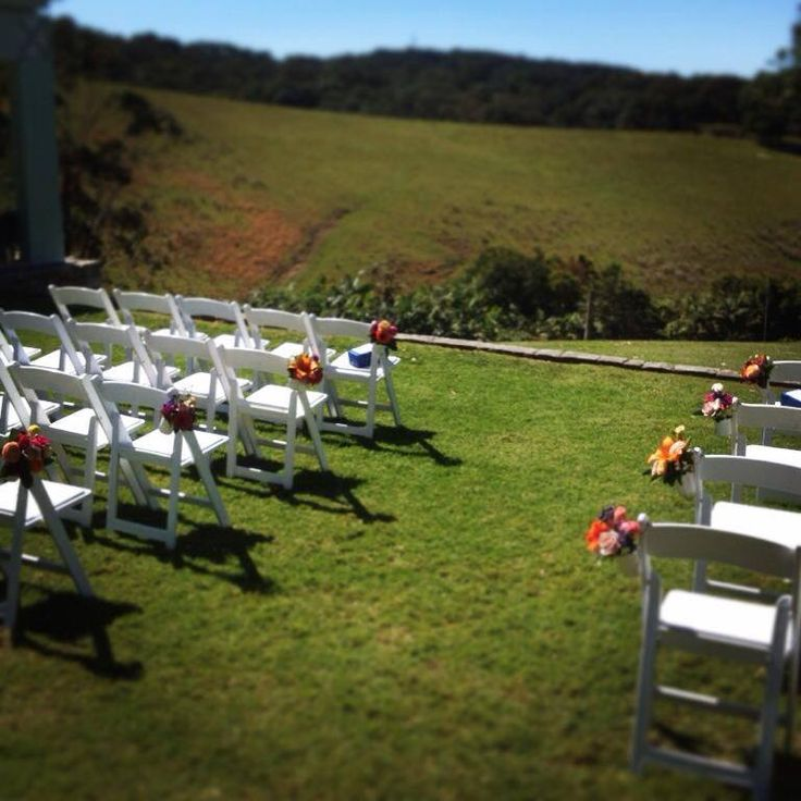 Simple but pretty Wedding Ceremony setting at Sea Farm.  Floral chair decorative elements by Angel Blooms.