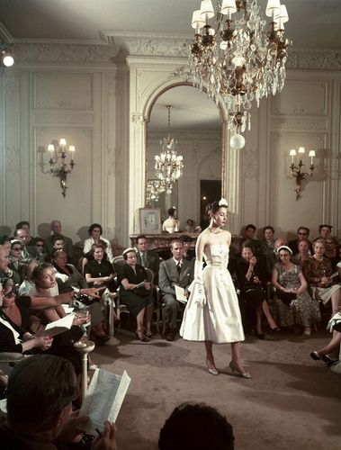 In 1950, Dior's runway show occupies an exquisite venue with marvelous trimwork.