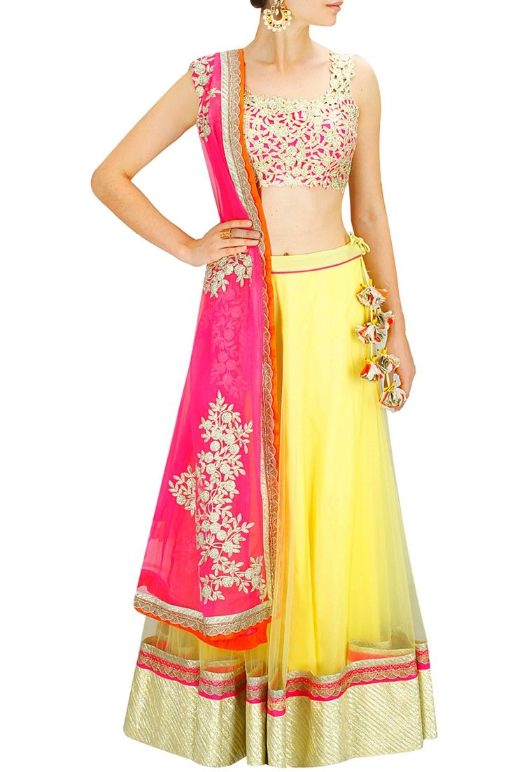 Yellow gota lace lehenga with gold cutwork blouse and pink embroidered dupatta. By Amrita Thakur. #designer #jewellery #fashion #indian #gold