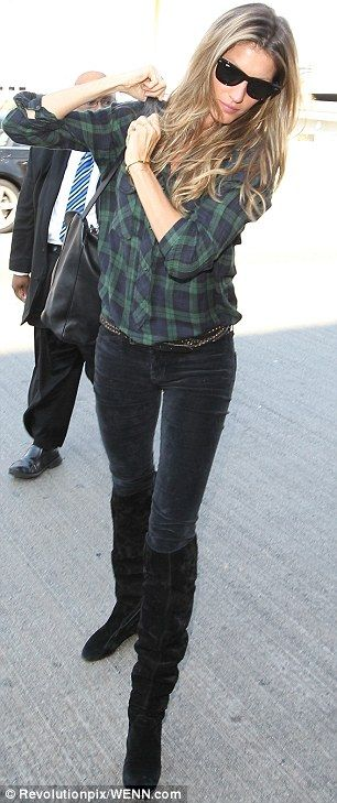 Fine in flannel: Gisele looked great in her blue and green plaid shirt