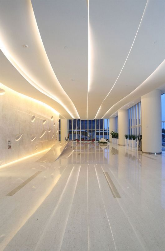 The tower and interiors express the culture and mission of the Septwolves Company. The tower's soft curves emulate fabric draped on the human figure, and the sinuous bands that form the lobby's ceiling are inspired by traditional Chinese linens rippling in the nearby South China Sea breeze.: