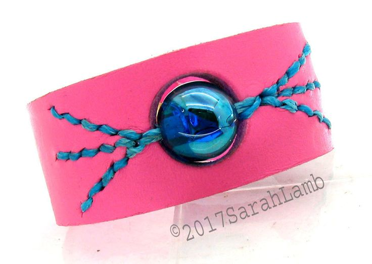 Pink leather cuff with blue lustre glass lampwork bead by sarahclamb on Etsy