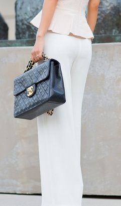 The bible of Fashion.... Hope to have this bag one day...and love the white on white!