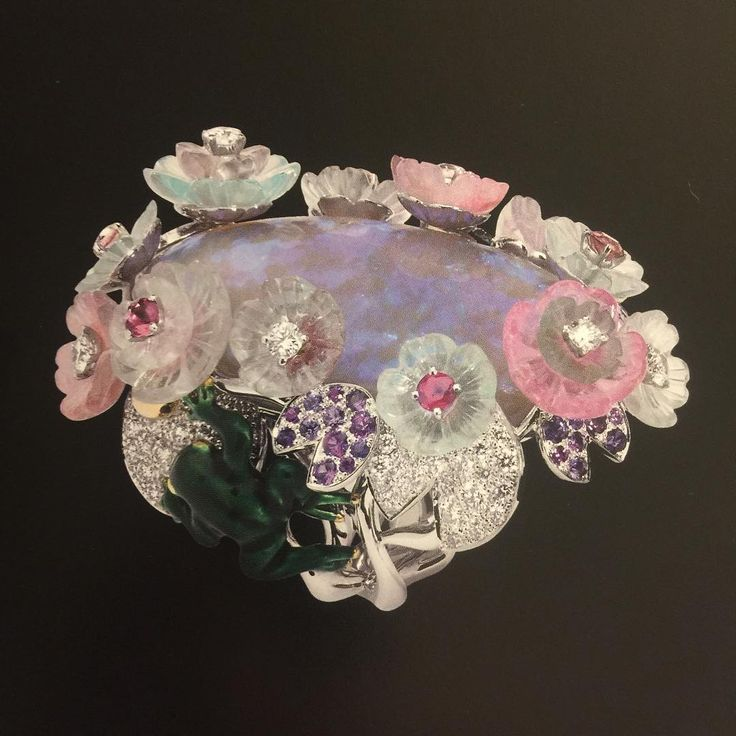 From the French jeweller extraordinaire Victoire de Castellane's 'Coffret de Victoire' collection for Christian Dior, a dazzling ring of enormous size, charm and whimsicality. The stones include diamonds, multi-coloured tourmalines and purple sapphires.
