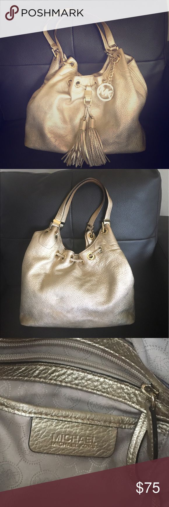 Michael Kors Middleton Gold Hobo purse Authentic Michael Kors drawstring handbag. Metallic gold. Signature MK circle emblem on gold chain. Clean inside with interior zipper pocket and cell phone/multi-use compartments. Second lowest price can be found at $413 at House of Fraser. Non-odorous in non-smoking household. Gently used with minor scuffs on the bottom. Michael Kors Bags Hobos