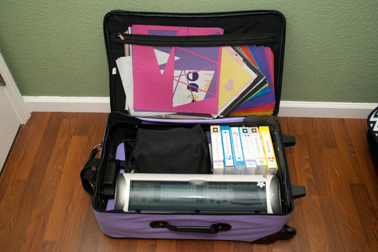 Cricut carry tote case bag with wheels, my old suitcase! Fits my cricut expressions, cartridges, paper, accessories, and small board. Cords go in the little black bag (old large make up bag) and I can even fit my laptop in it. Great for storage and to travel with.