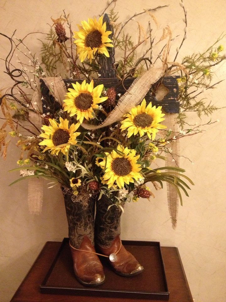 Not a huge fan of the colors, but an arrangement out of boots is a cute idea