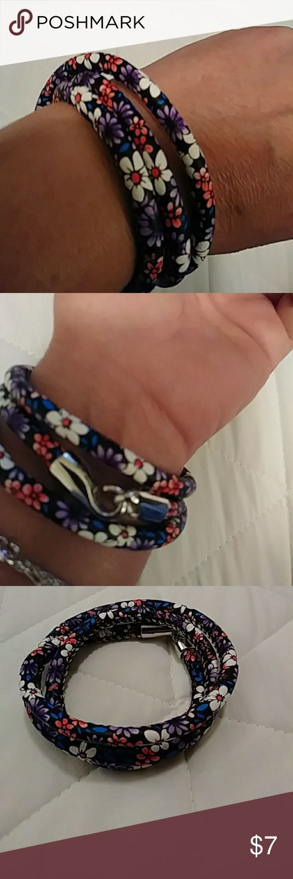 Floral Wrap Bracelet Fabric bracelet with pretty flowers...someone gave it to my granddaughter and it's too big for a 6 year old so she wants to sell it and make money too! I actually will be giving her the money and tell her it sold. Jewelry Bracelets