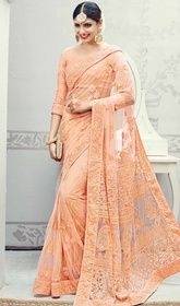 Peach Color Embroidered Net Designer Sari   #designerssareecollection #designersareecom Real attractiveness comes out of your dressing trend with this peach color embroidered net designer sari. The desirable lace, resham and stones work a substantial attribute of this attire. Upon request we can make round front/back neck and short 6 inches sleeves regular saree blouse also.  USD $ 279 (Around £ 193 & Euro 212)
