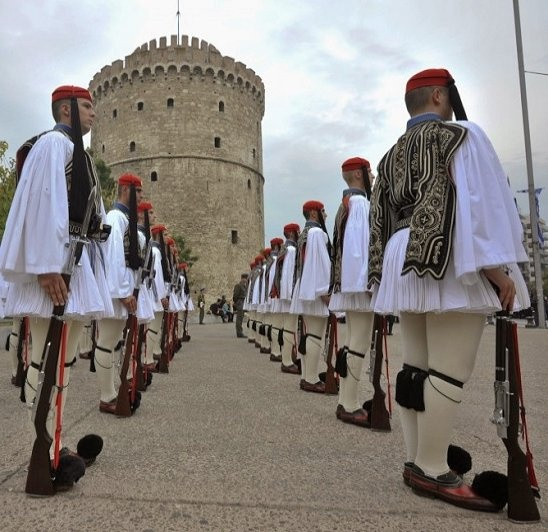 Greece's presidential guards stand before Thessaloniki's White Tower.