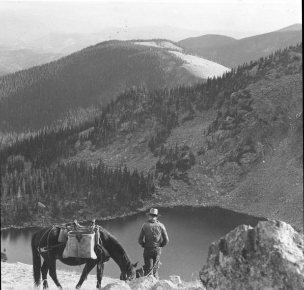 Rider above Lake Katherine in the Sangre de Cristo Mountains, Santa Fe, New Mexico, ca. 1950. Palace of the Governors Photo Archives HP.2007.20.638.